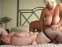 Two ultrafat ladies play with dildo